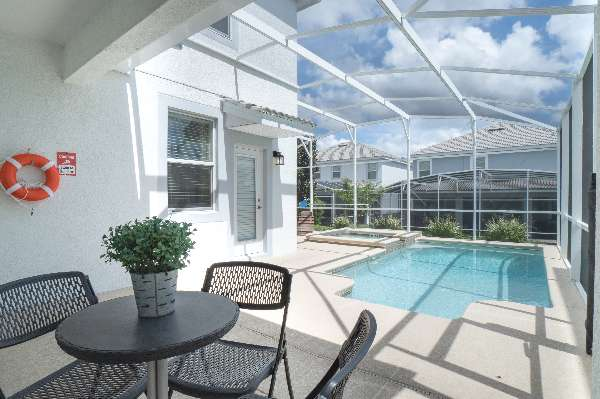 Take a swim in your private pool and spa under a covered lanai