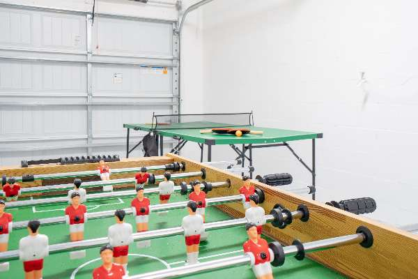 Air Hockey, Foosball, and Ping Pong in the Garage game room
