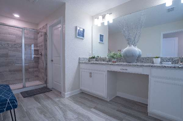 Spacious master en suite bathroom with double vanity for all your essentials