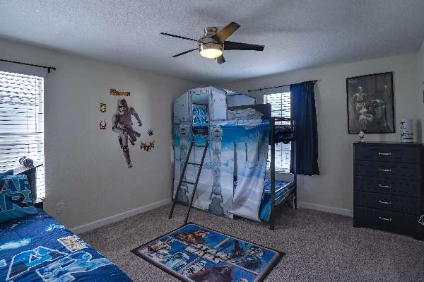 Fun Star Wars bedroom adventure with bunk bed, separate twin, and trundle